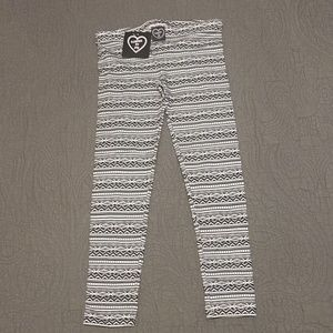 NWT patterned girls leggings size M (10/12)